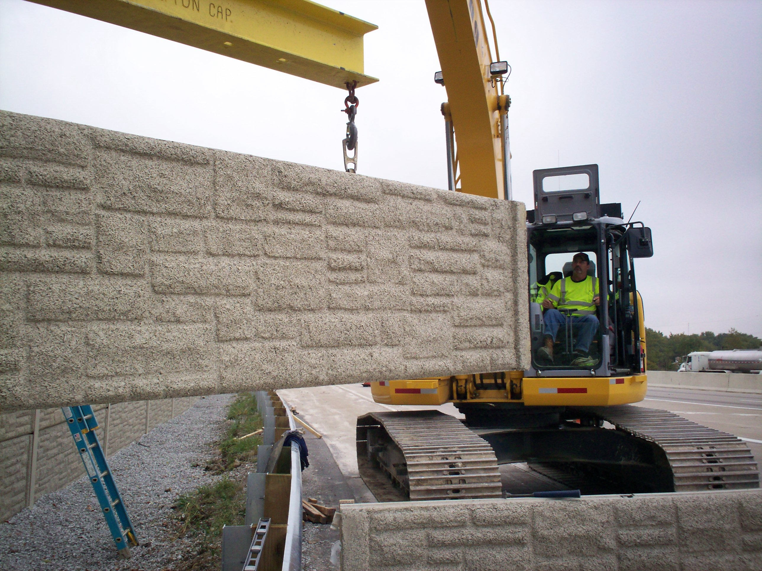 Anthony AJ Poulton setting the wall on 465 for Kokosing Construction Co.