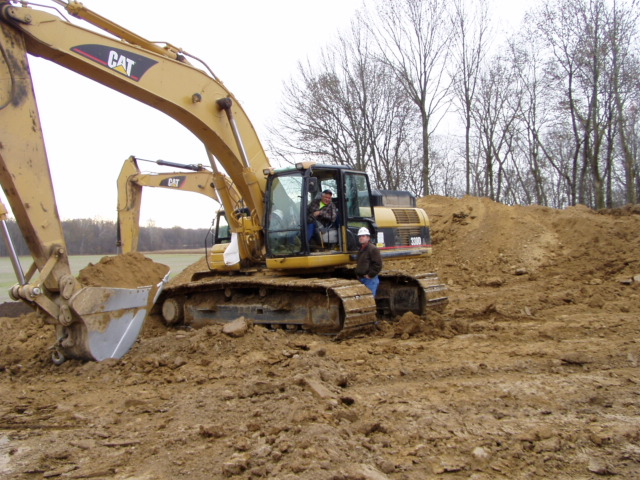 Frank Bowling operating an excavator and Brian Bramer at the Rockies Express Pipeline
