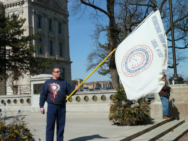 Gary Turnmire raising the Local 103 flag at the State House