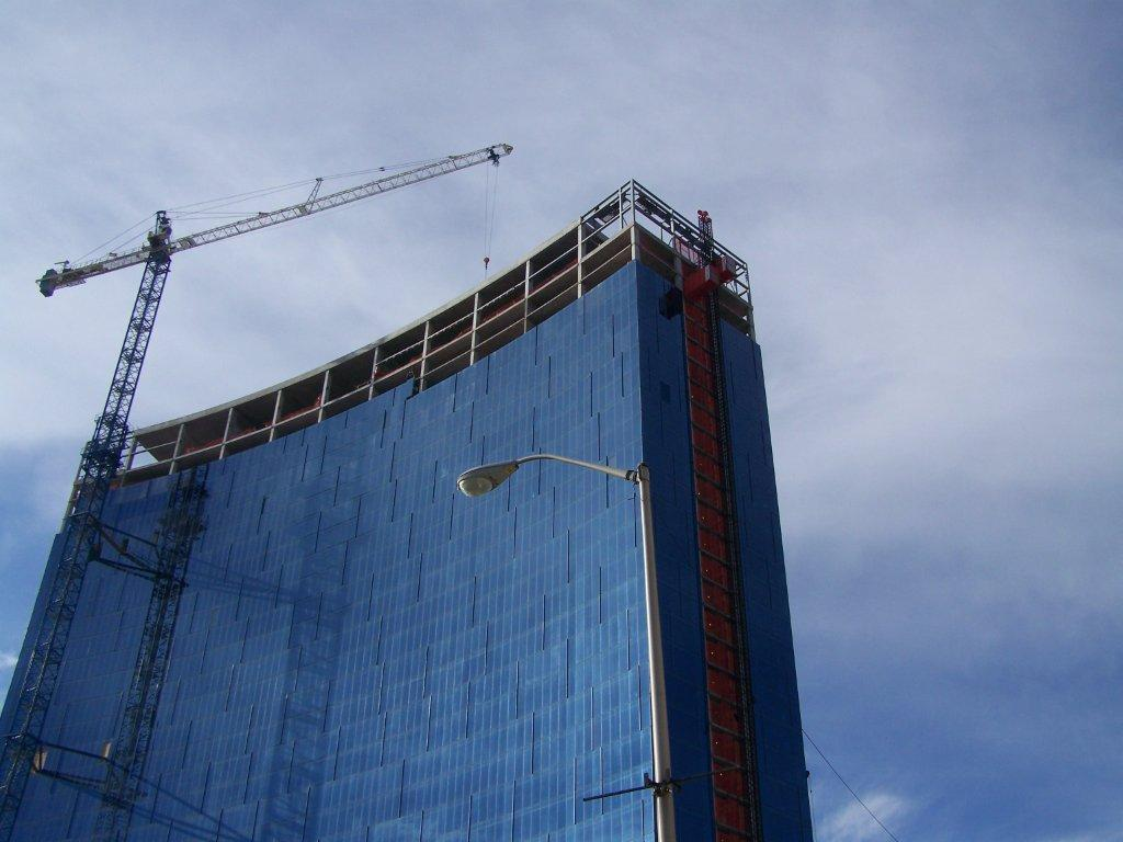 Kelli Seybold runs the tower crane while Tim Fields and Tim Browder run the hoist at the new Marriott in Indianapolis