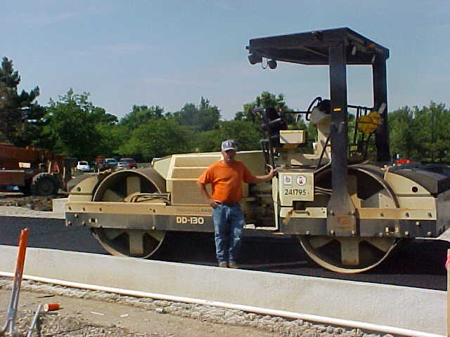 Leonard Allred with his asphalt roller at Ball State