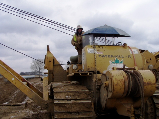 Mike Craft standing on the sideboom at the Rockies Express Pipeline job