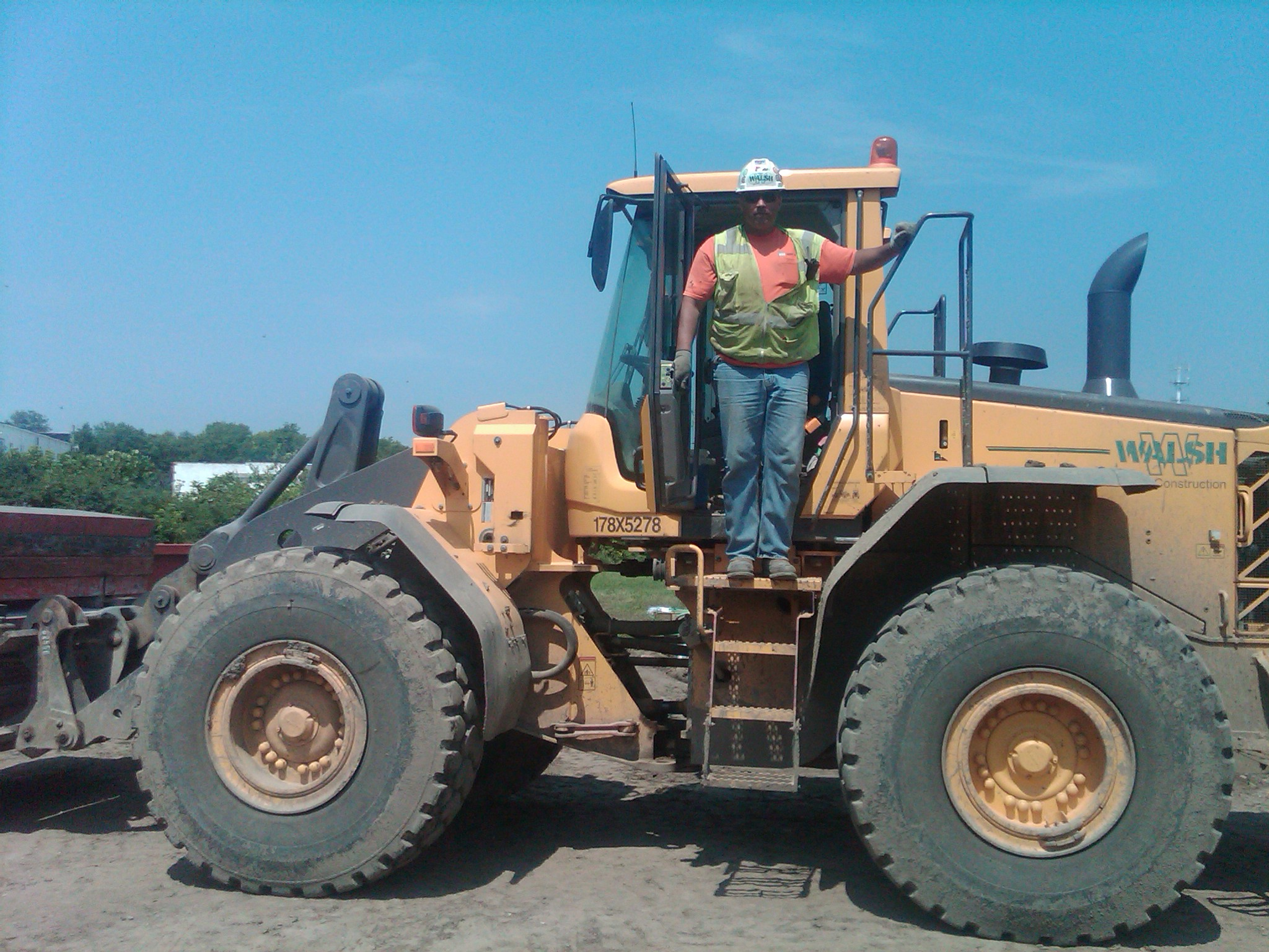 Tim Thomas stands on his Walsh loader at the I465 job